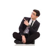 Sitting male student pointing. Royalty Free Stock Photos