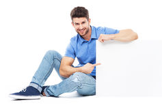Sitting man with empty poster Stock Photography
