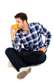 Sitting man with an orange Stock Image