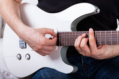Sitting man playing the guitar Royalty Free Stock Photo
