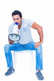 Sitting man shouting through megaphone Royalty Free Stock Photos