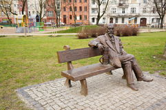Sitting man statue Stock Image