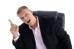 Sitting manager indicating upward Stock Photo