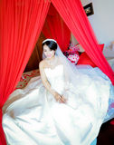 Sitting in the marriage bed bride Stock Photos