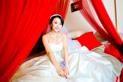 Sitting in the marriage bed bride Stock Images
