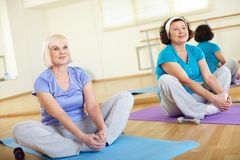Sitting on mats Stock Images