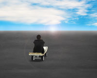 Sitting on money skateboard moving toward sunrise Royalty Free Stock Photos