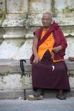 Sitting monk Stock Photo