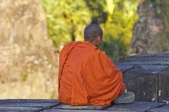 Sitting monk Stock Image