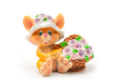Sitting mouse with basket of flowers. Isolated on white background royalty free stock photos