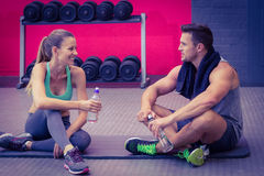 Sitting muscular couple talking together Stock Photo
