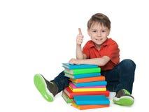 Sitting near books cheerful boy Stock Photos
