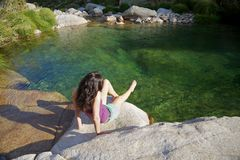 Sitting next to a river at Gredos Royalty Free Stock Photo