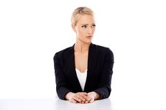 Sitting Office Woman Looking to her Left Side Royalty Free Stock Photos
