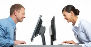Sitting opposite. Two business colleagues sitting opposite at their monitors royalty free stock photos