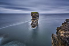 Sitting out in the wild Atlantic Ocean, Downpatrick Head is an area Stock Photography