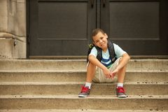 Sitting outside of school Royalty Free Stock Images