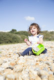 Sitting on a pebble beach royalty free stock images