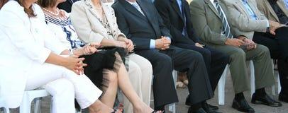 Sitting people Stock Photo