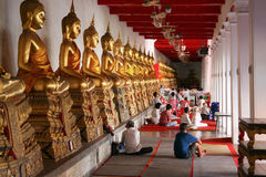 Sitting people with Sitting Buddha. Bangkok, Thailand, South-East Asia, Asia Stock Photo