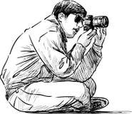 sitting photographer Royalty Free Stock Photography