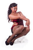 Sitting pinup in red and black Stock Photo