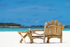 Sitting place and table in a tropical beach Royalty Free Stock Photo