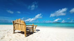 Sitting place and table in a tropical beach Stock Image