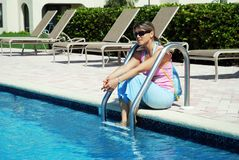 Sitting By The Pool Stock Images