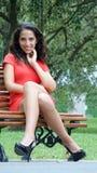 Sitting Pretty Female. A pretty young Peruvian adult female Stock Photo