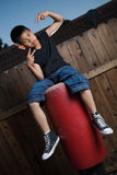 Sitting on a punching bag Royalty Free Stock Photo