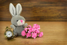 Sitting rabit with flowers Stock Photos