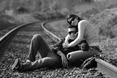 Sitting on railway tracks Royalty Free Stock Image