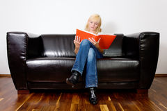 Sitting and reading Royalty Free Stock Photos