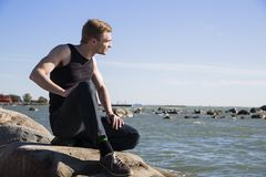 Sitting on rock and meditating with concentration Stock Photography