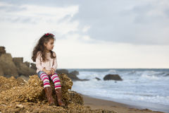 Sitting on rock Royalty Free Stock Photo