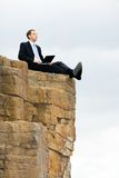 Sitting on the rocks Royalty Free Stock Image