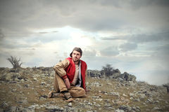 Sitting on rocks Stock Photography