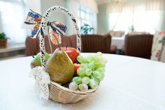The sitting-room with basket of fruits Royalty Free Stock Photography