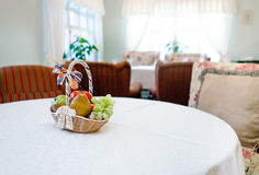 The sitting-room with basket of fruits Stock Image
