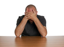 Sitting sad man from curtained with palms face Royalty Free Stock Photos