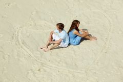 Sitting on sand Royalty Free Stock Images