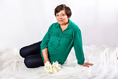 Sitting senior woman Royalty Free Stock Photography