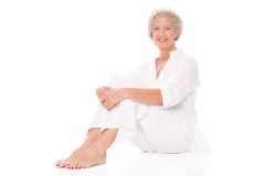 Sitting senior woman Royalty Free Stock Photo