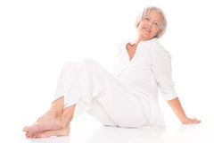 Sitting senior woman Stock Images
