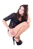 Sitting sexy woman in lace lingerie and shoes on heels isolated Royalty Free Stock Photo