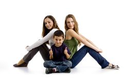 Sitting siblings with thumbs up. On an isolated background Royalty Free Stock Photo