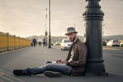 Sitting on the sidewalk Royalty Free Stock Images