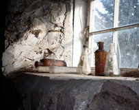 Sitting in Silence. Old glass bottles abandoned in barn Royalty Free Stock Photos