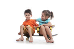 Sitting on a skate  board Royalty Free Stock Image